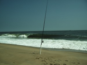 Surf fishing reel and rod with sand spike this is a typical surf fishing set up.