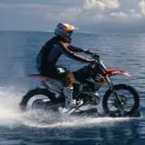 Robbie Maddison rides his dirt bike on water