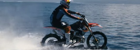 Robbie Maddison rides his dirt bike on water